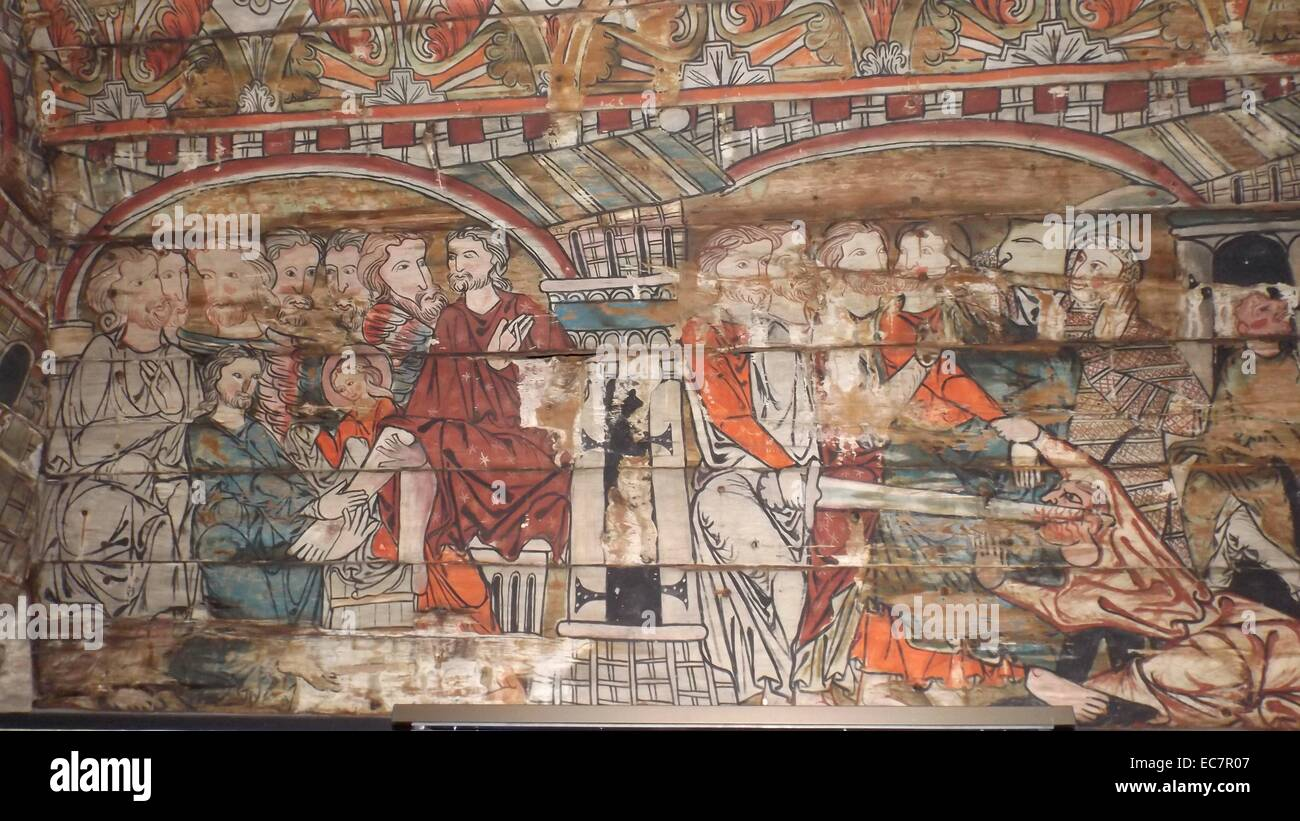 The ceiling panels preserved from a Norwegian Church dating to 1200 AD. The washing of feet is shown - Stock Image