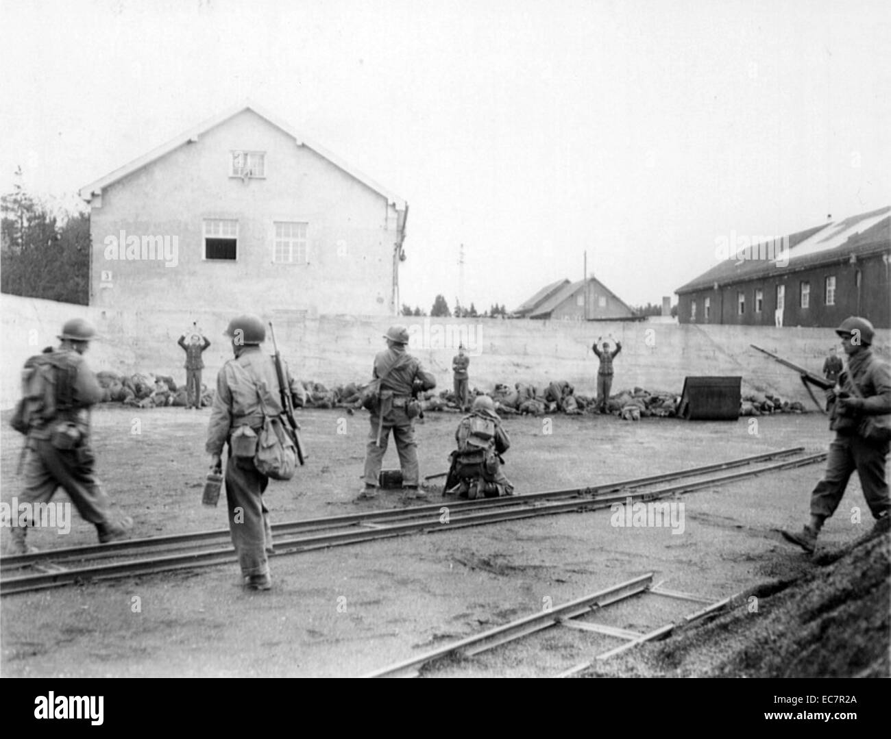 Photograph of American soldiers executing guards of the Dachau Concentration Camp. Dated 1945 - Stock Image