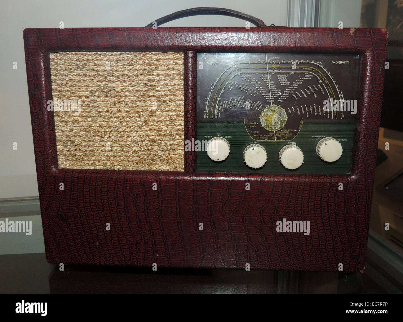 Courier radio receiver from 1950 has 4 radiator combined net and battery receiver. Dated 1950 - Stock Image