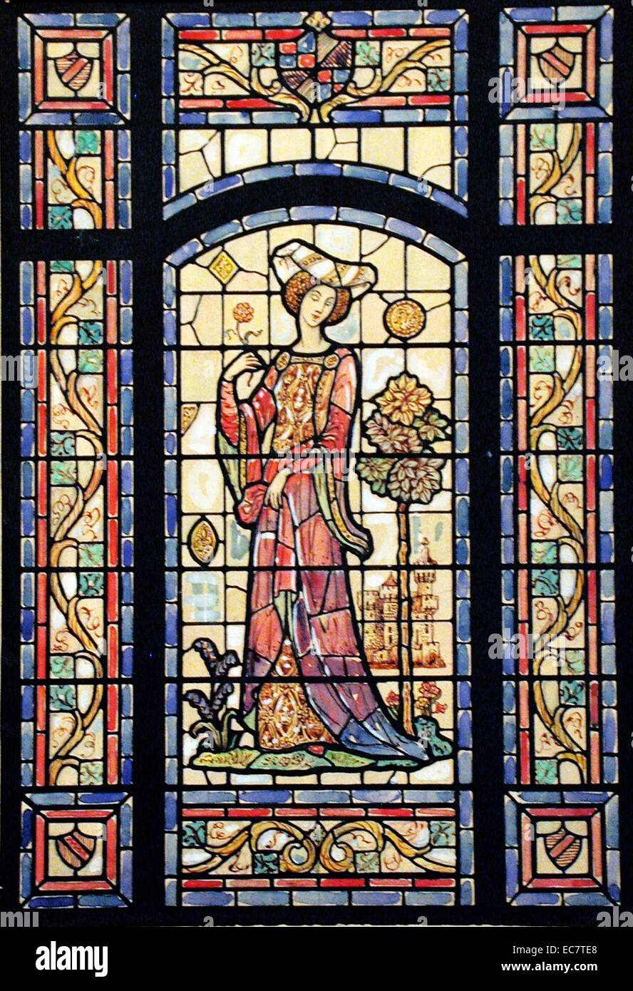 A stained glass window for C.F. Bohn Residence in Grosse Pointe, Michigan. It shows a romantic Medieval lady with - Stock Image