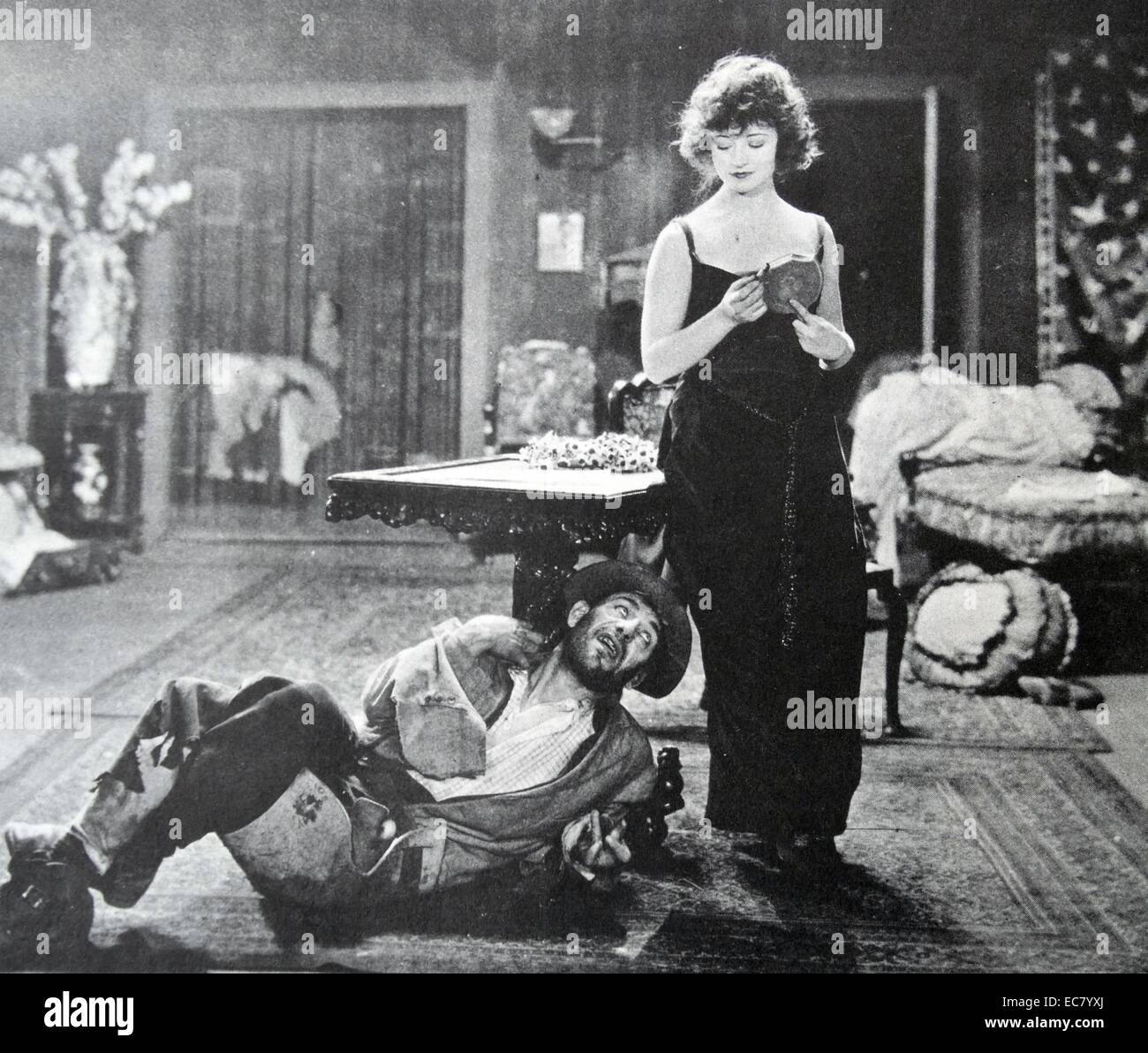 Lon Chaney's deformed cripple, seen here with Betty Compson in 'The Miralce Man' 1920 made his reputation. - Stock Image