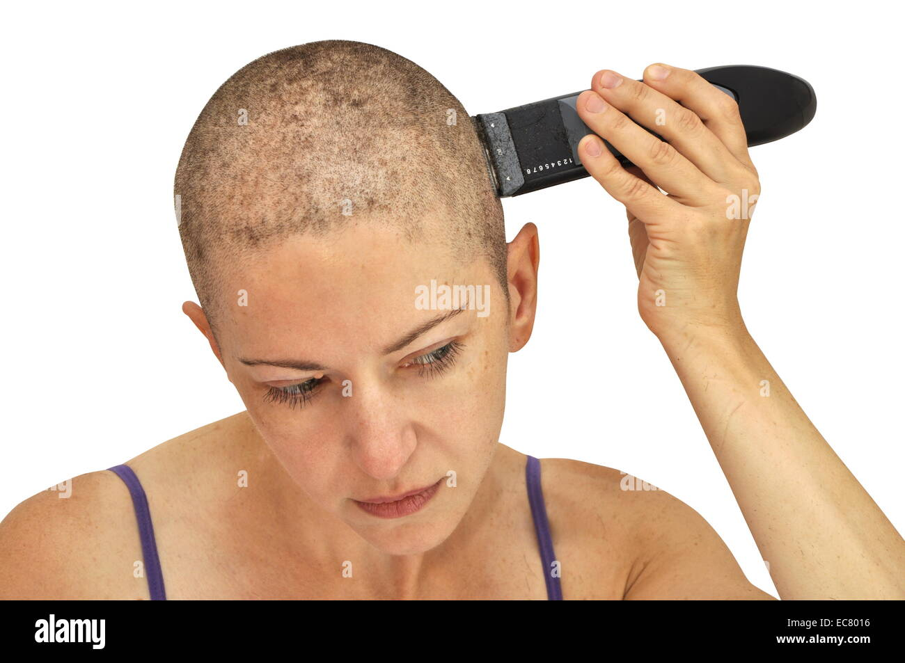 Woman shaving herself bald using left hand, closeup, isolated on white. - Stock Image