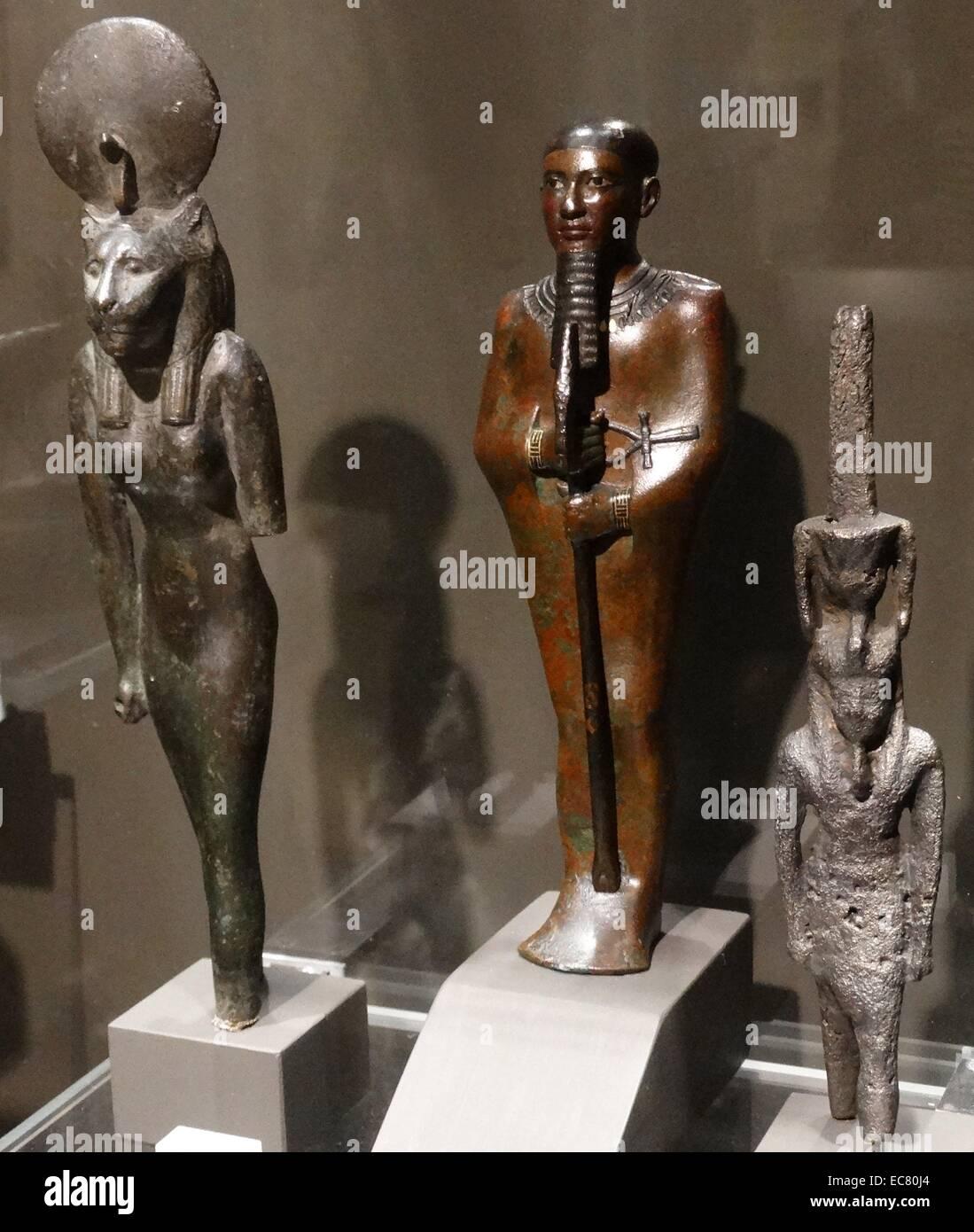 Left to right: Egyptian gods, Sekhmet; Ptah and Nefertum - Stock Image