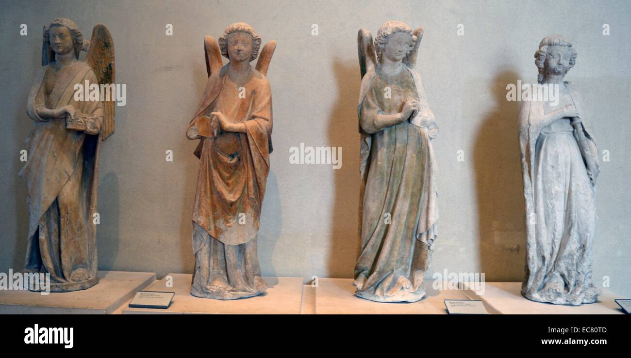 Marble statue of Angel holding a crown. Ile-de-France, beginning of the XI century. - Stock Image