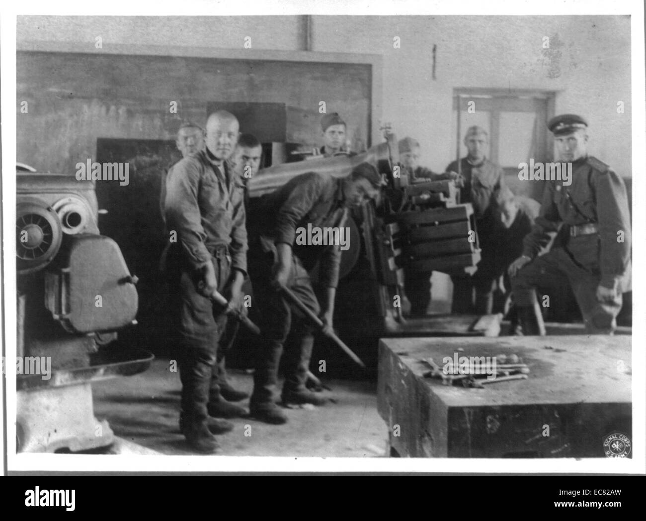 Soviet soldiers in process of removing industrial equipment from Manchurian factories, during the second world war - Stock Image