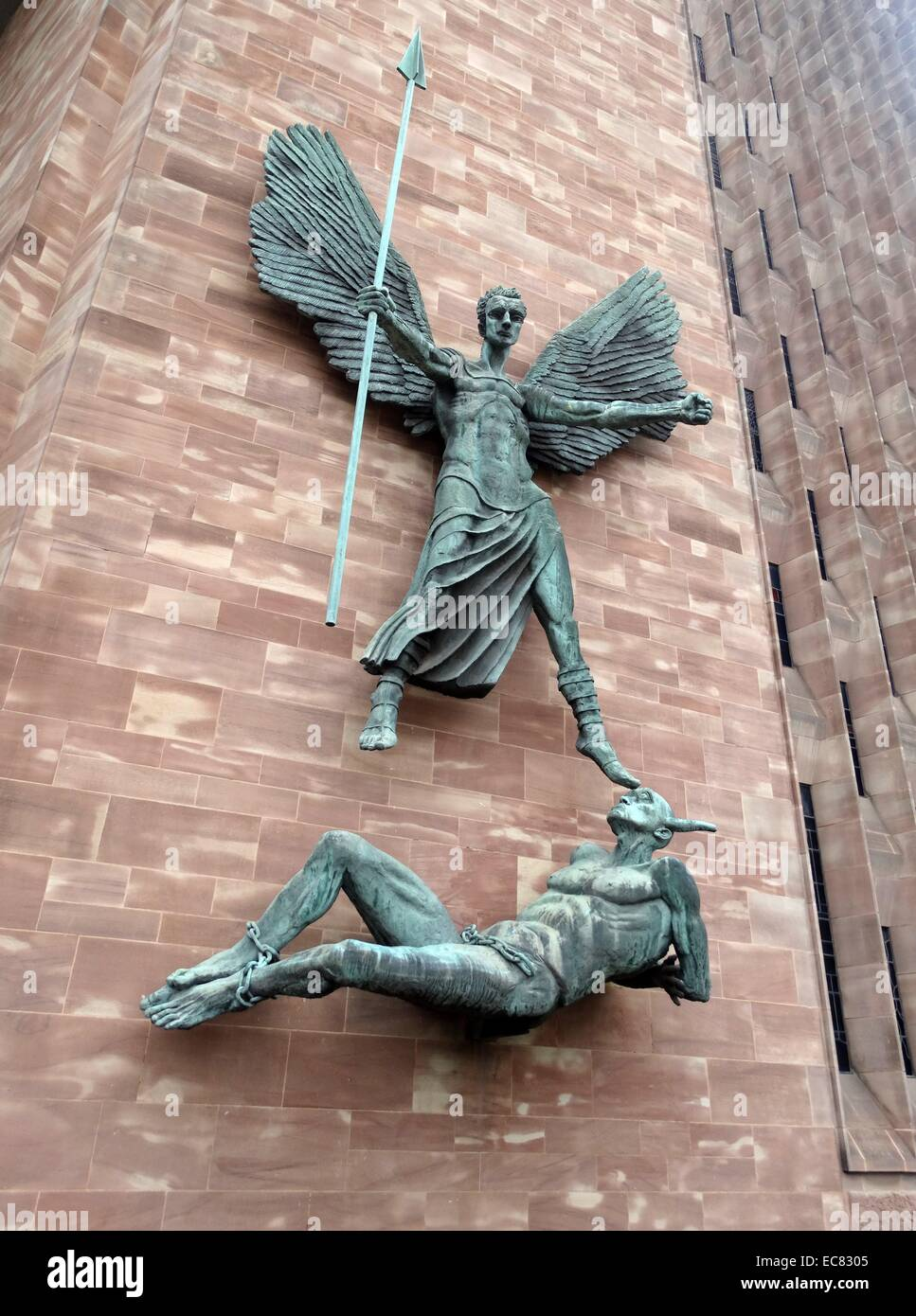 St Michael and the Devil. Sculpture by Jacob Epstein at St Michael's Cathedral, Coventry - Stock Image
