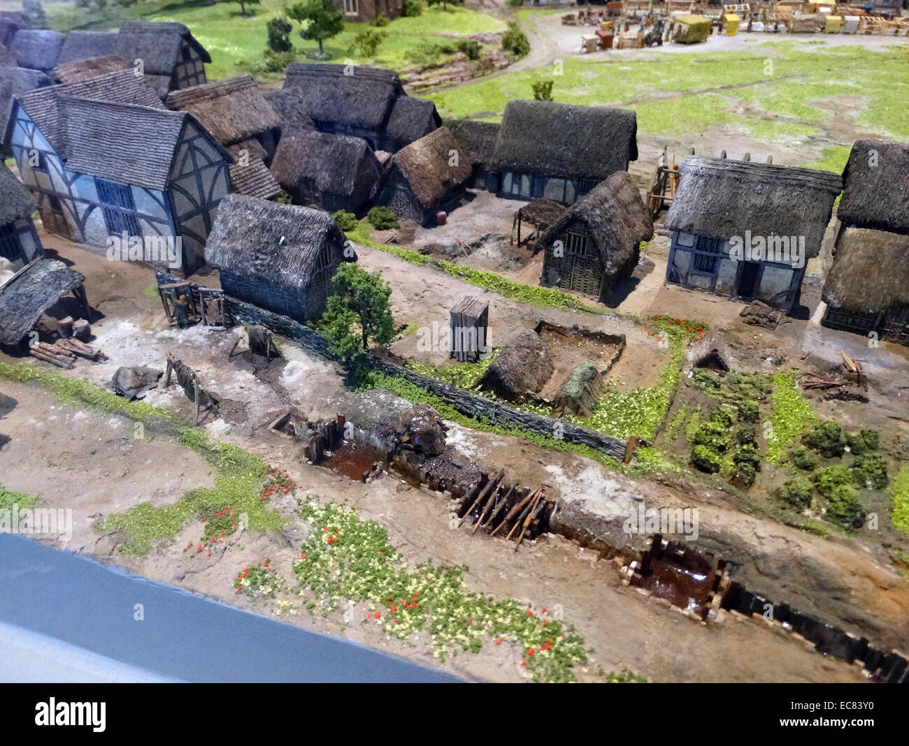 Model of homes in Birmingham 1300. All of the homes have thatched roofs and are arranged around a central point. - Stock Image