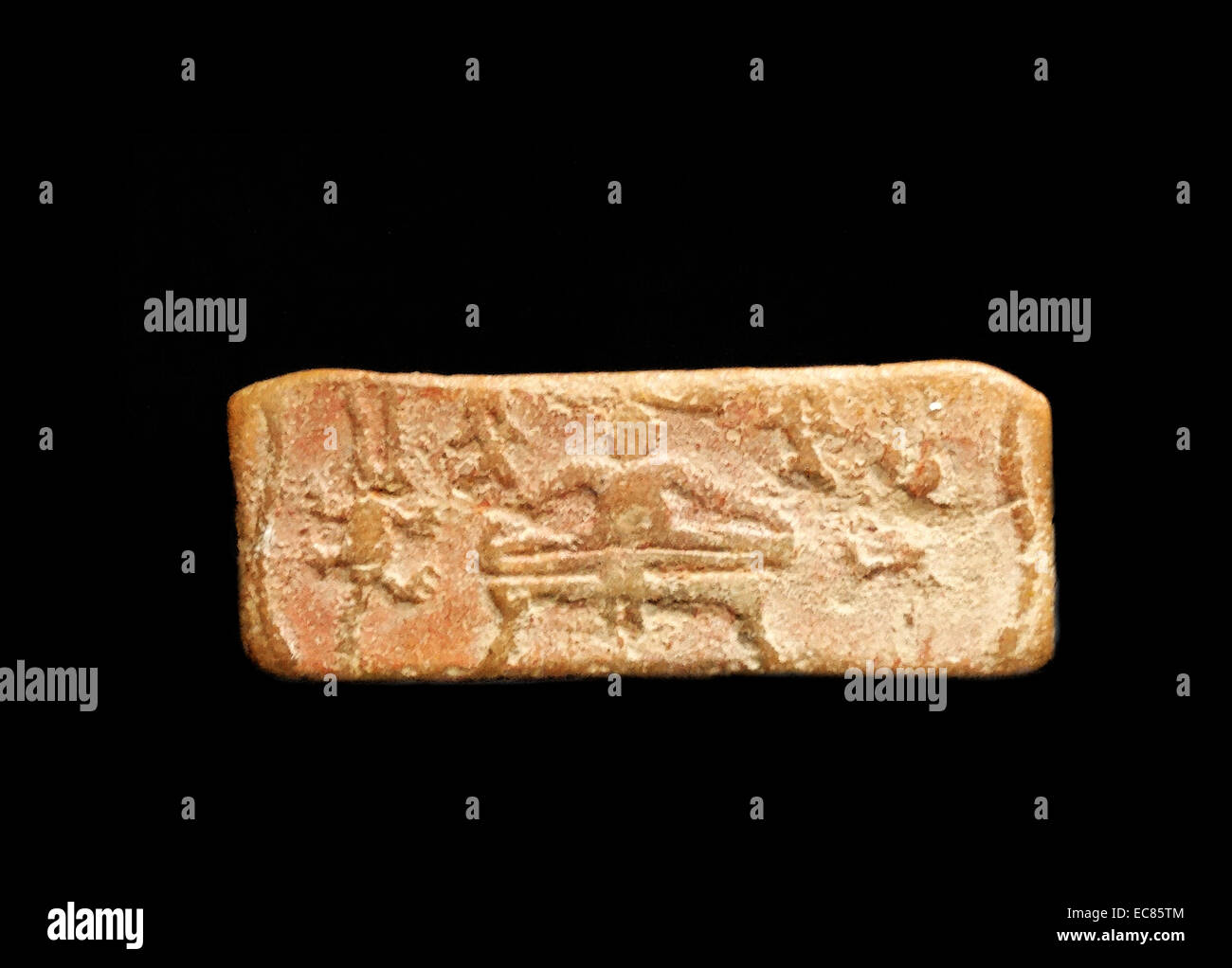 Terracotta seal with a male cult figure; from the Indus Valley - Stock Image