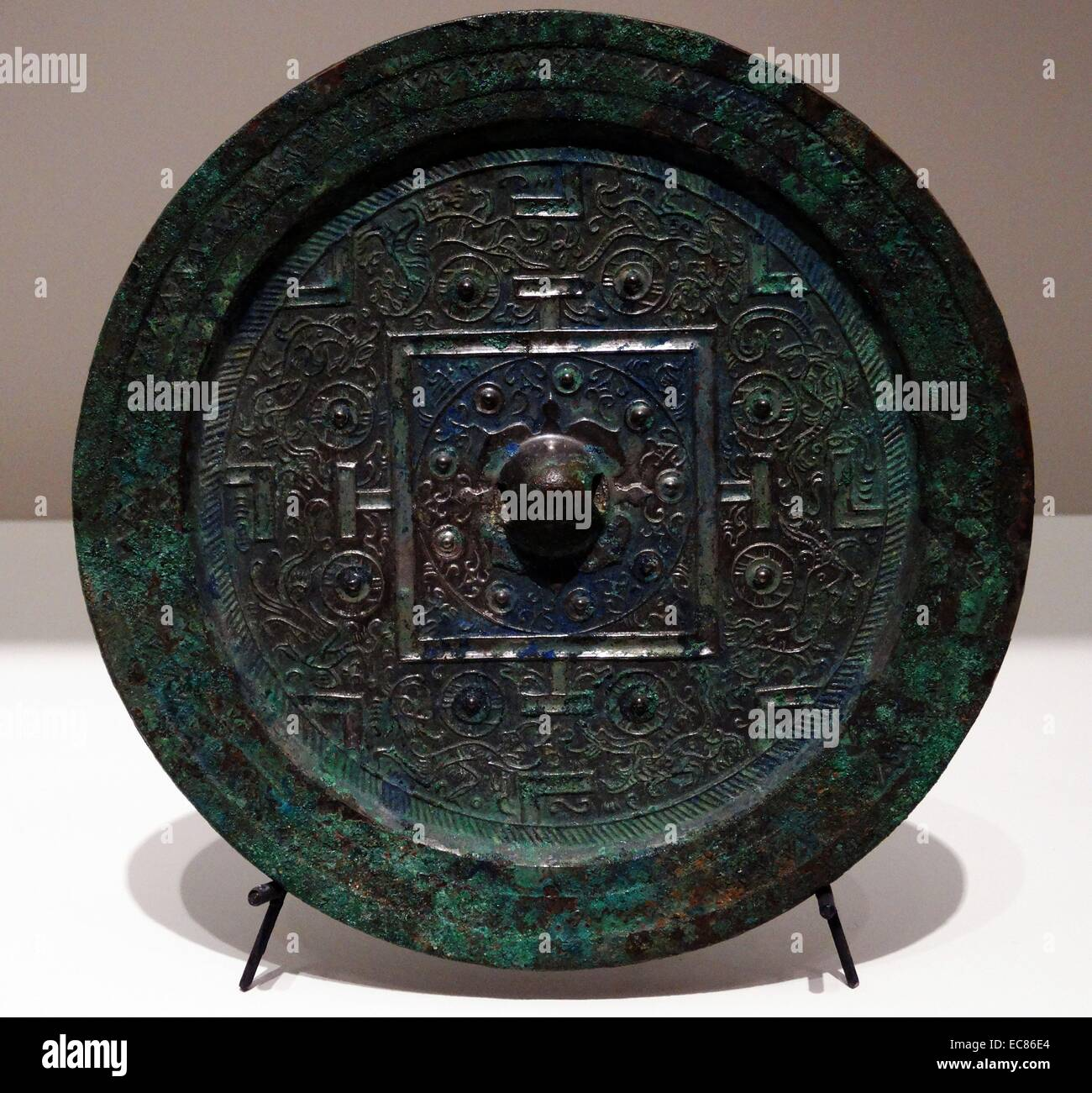 Bronze Mirror with Geometric Patterns and Stylised animals. 200 BC. Stock Photo