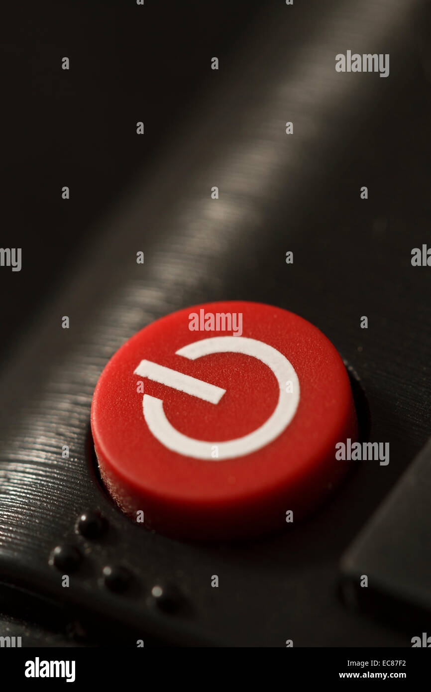remote control on off button close-up macro shot - Stock Image