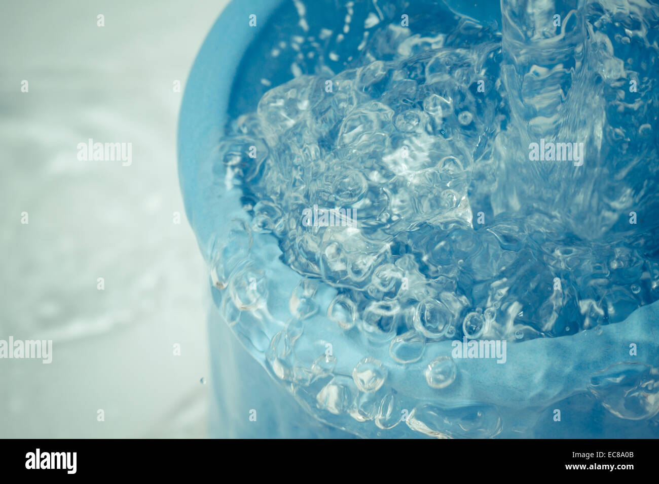 cup container pot coffe grounds; water splashing movement; - Stock Image