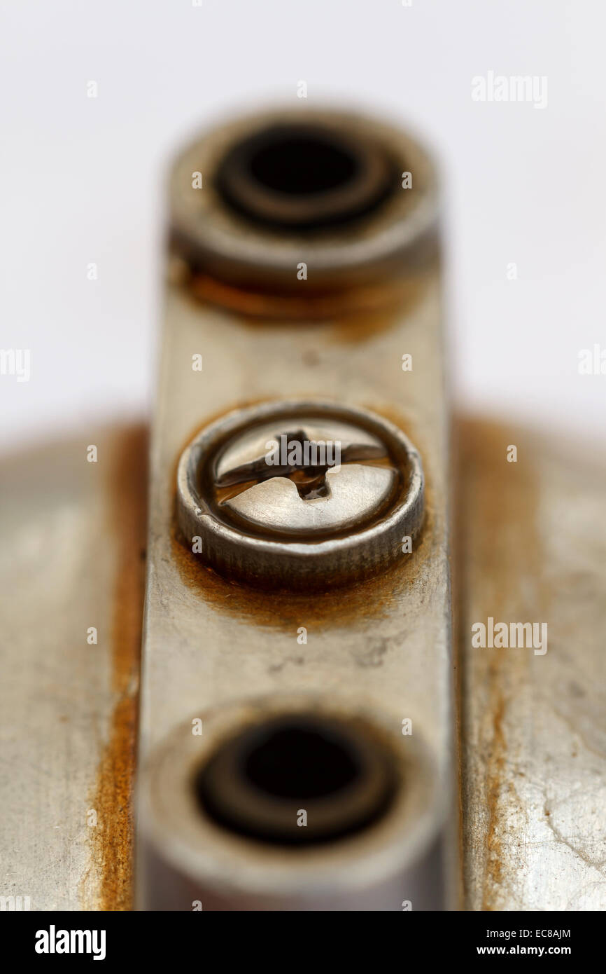 under metal coffee machine, close-up macro shot - Stock Image