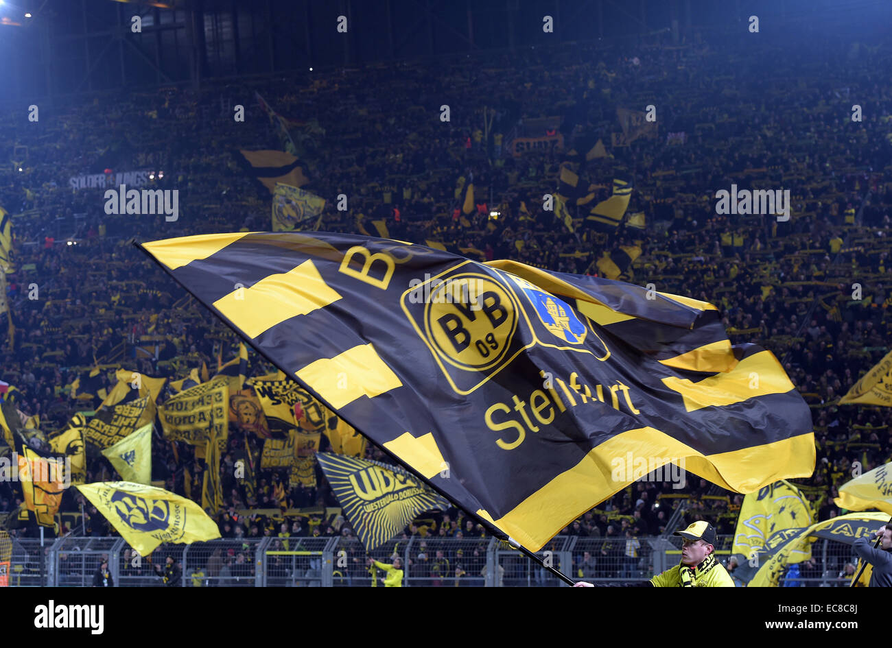 Dortmund's fans wave the flag during the Champions League Group D football match between BorussiaDortmund - Stock Image