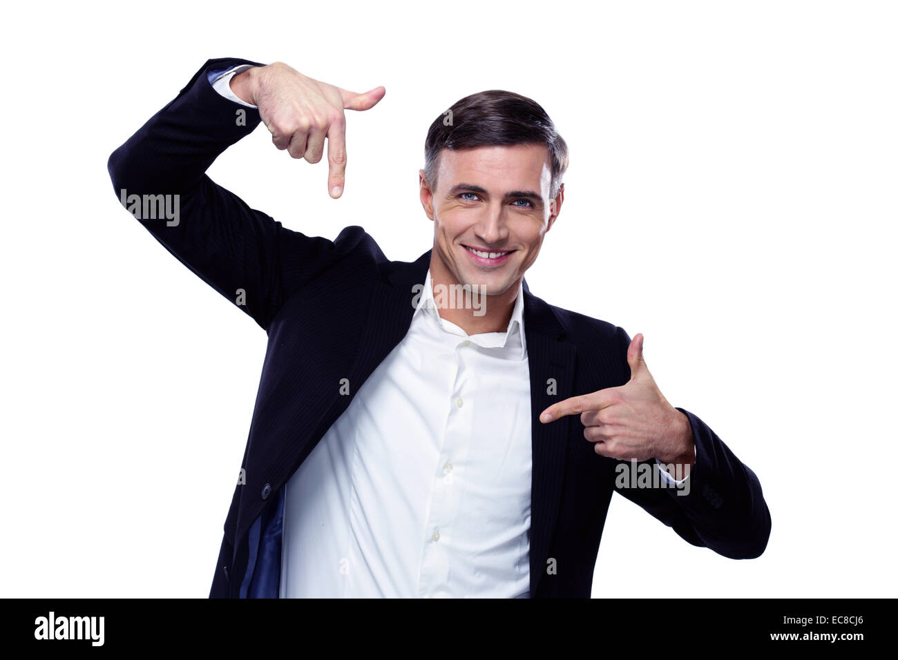 Businessman in formalwear gesturing finger frame over white background - Stock Image