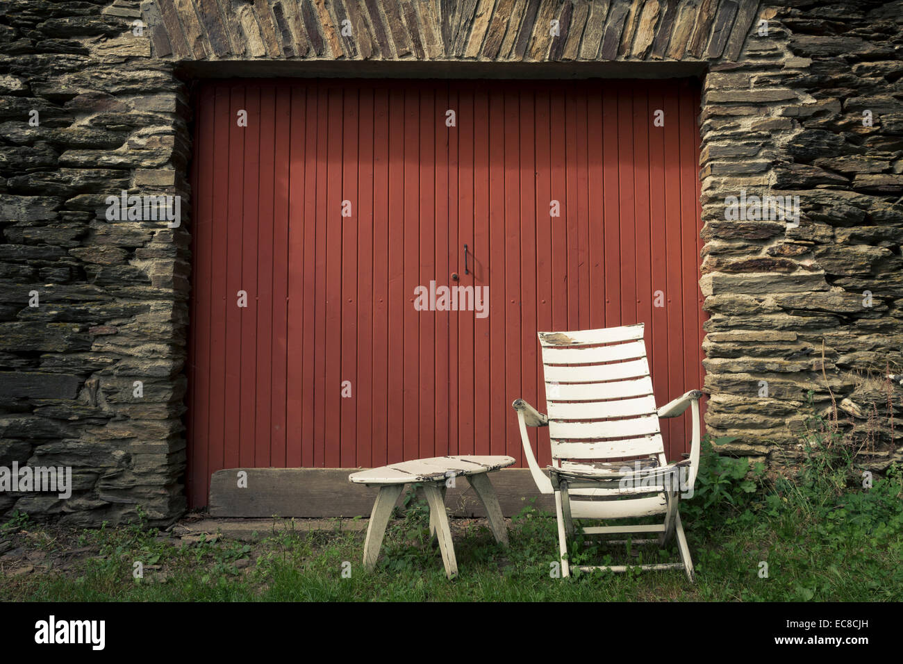 schist stones old table old chair - Stock Image