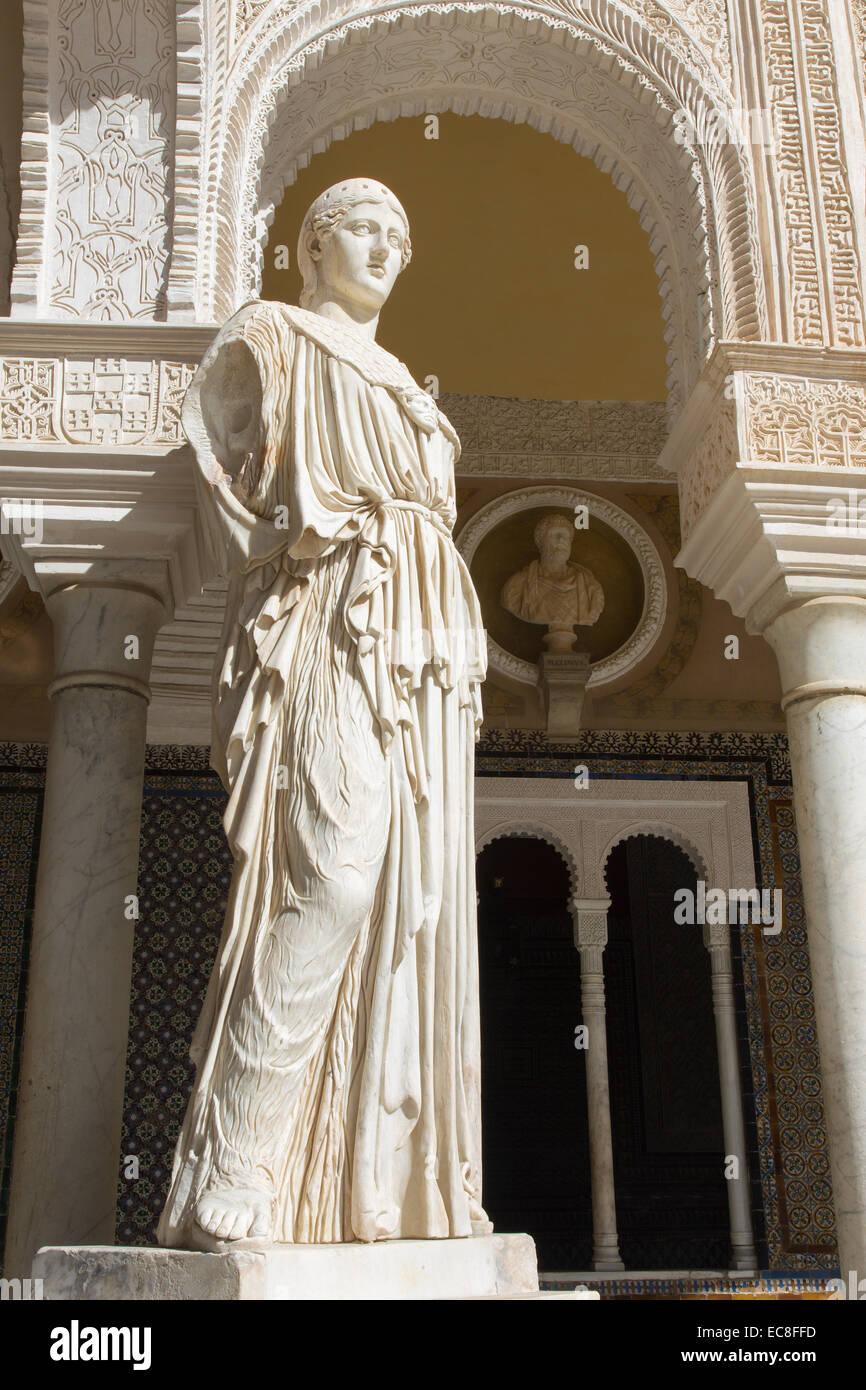 SEVILLE, SPAIN - OCTOBER 28, 2014: The copy of antique statue Pallas Pacifera in the Courtyard of Casa de Pilatos. - Stock Image