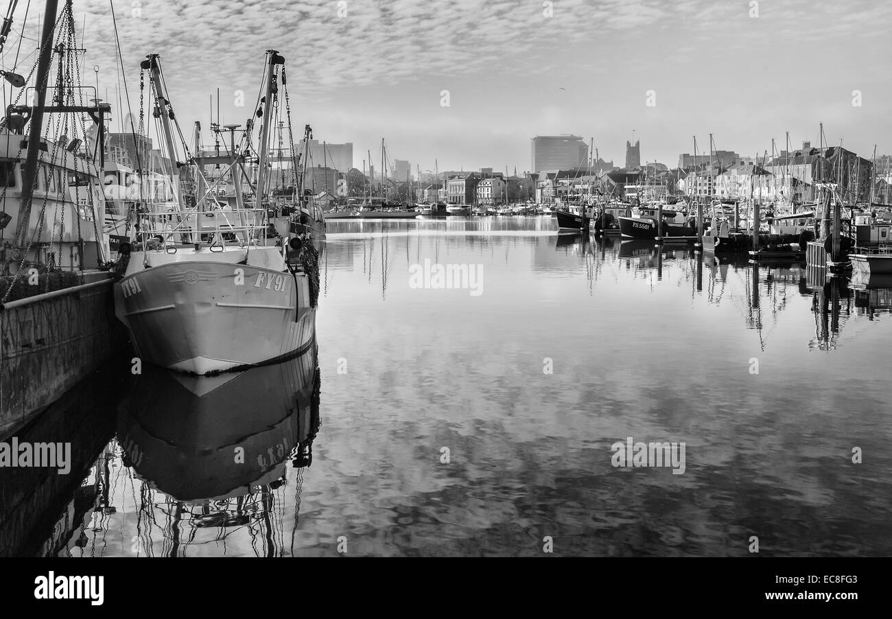 Fishing boats anchored in Barbican Center harbour on a fresh fine winter's morning on March 02, 2012 at Plymouth, - Stock Image