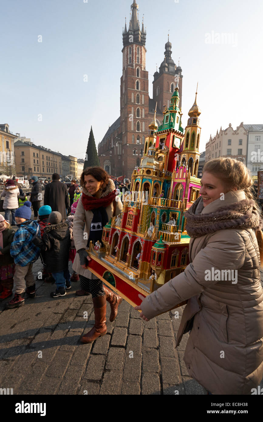 Krakow Christmas Cribs winners carrying crib to the Historical Museum of Kraków in Krzysztofory palace. - Stock Image