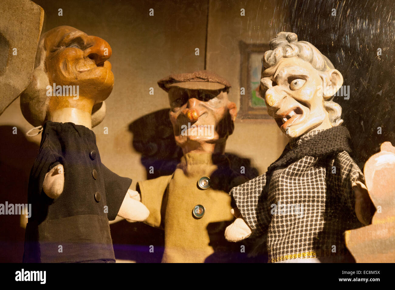 Old wooden puppets in the Museum of Folklore, Bruges, Belgium - Stock Image