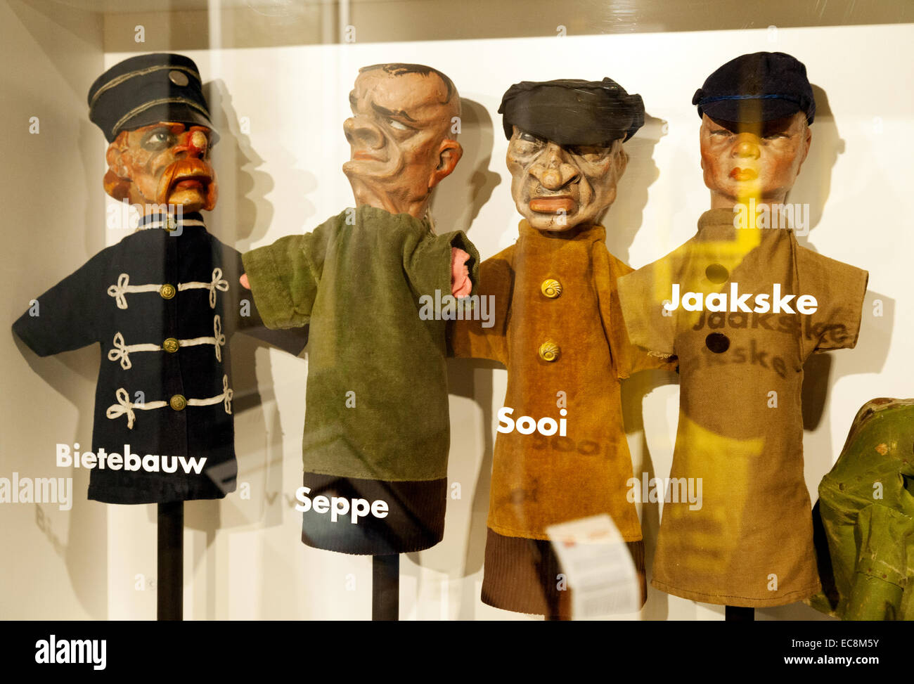 Old wooden Belgian / Flemish puppets, The Folklore Museum, Bruges Belgium - Stock Image