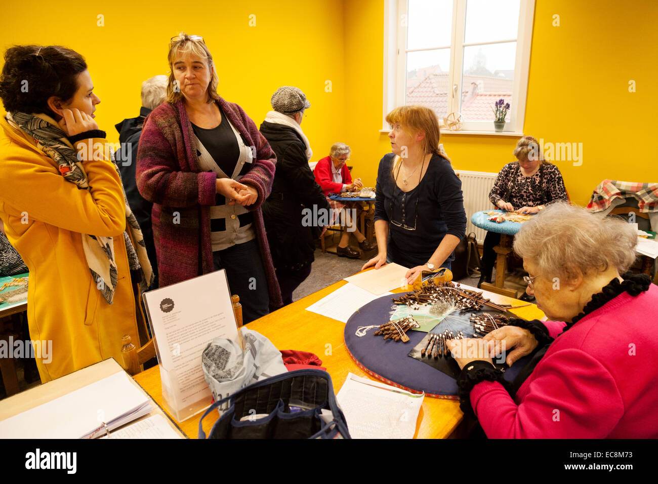 A lace making demonstration in the Lace Museum, Bruges, Belgium, Europe Stock Photo