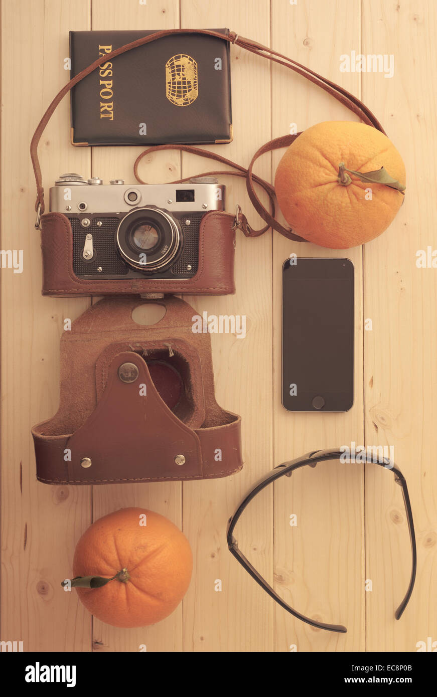 Travel set of things sunglasses, passport, camera phone and tropical fruits oranges - Stock Image
