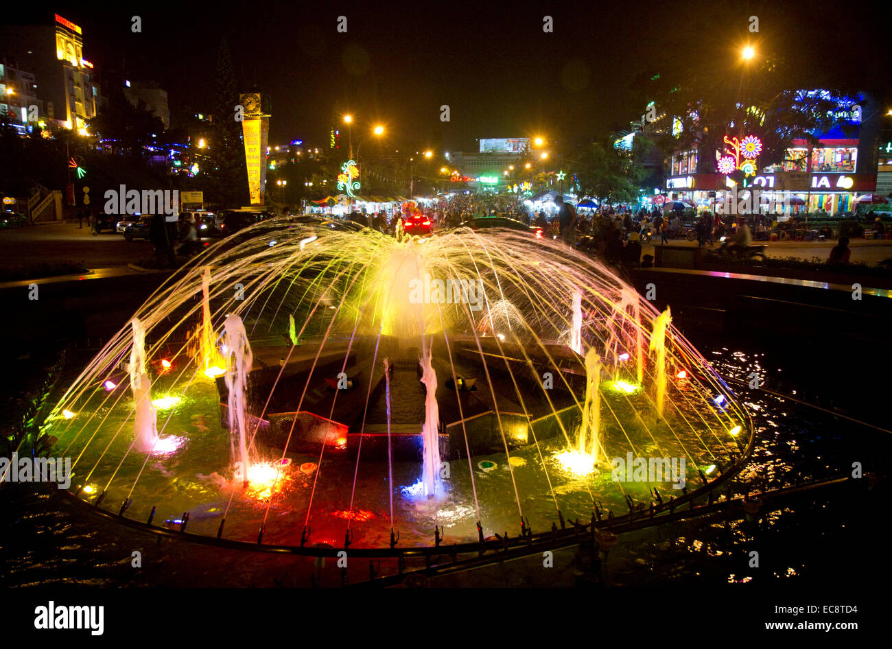 Water fountain lit with colored lights at night in Da Lat, Vietnam. - Stock Image