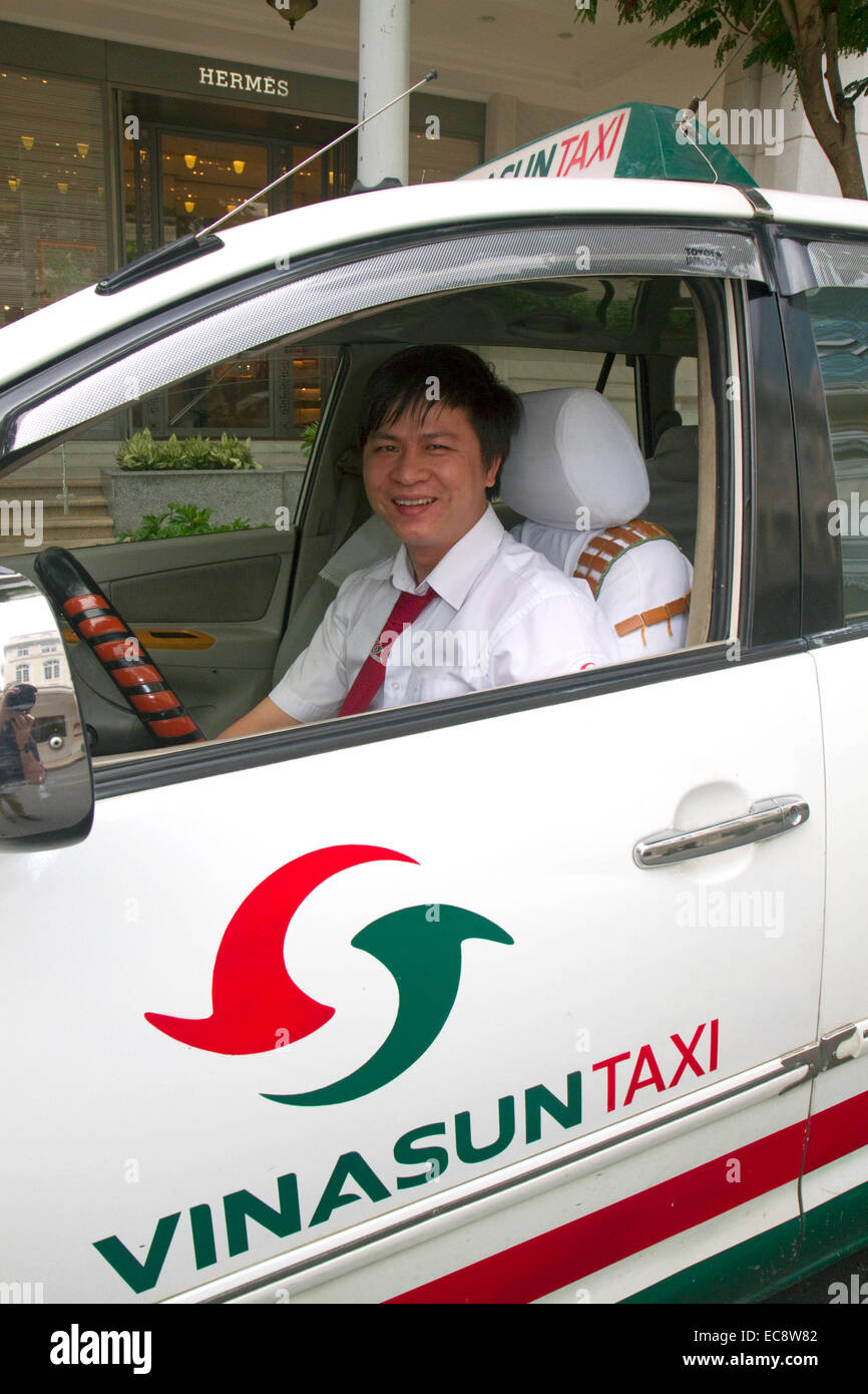 Vina Sun taxi and driver in Ho Chi Minh City, Vietnam. - Stock Image