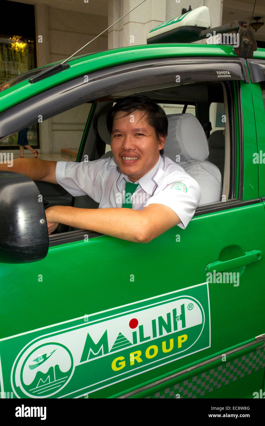 Mai Linh taxi and driver in Ho Chi Minh City, Vietnam. - Stock Image