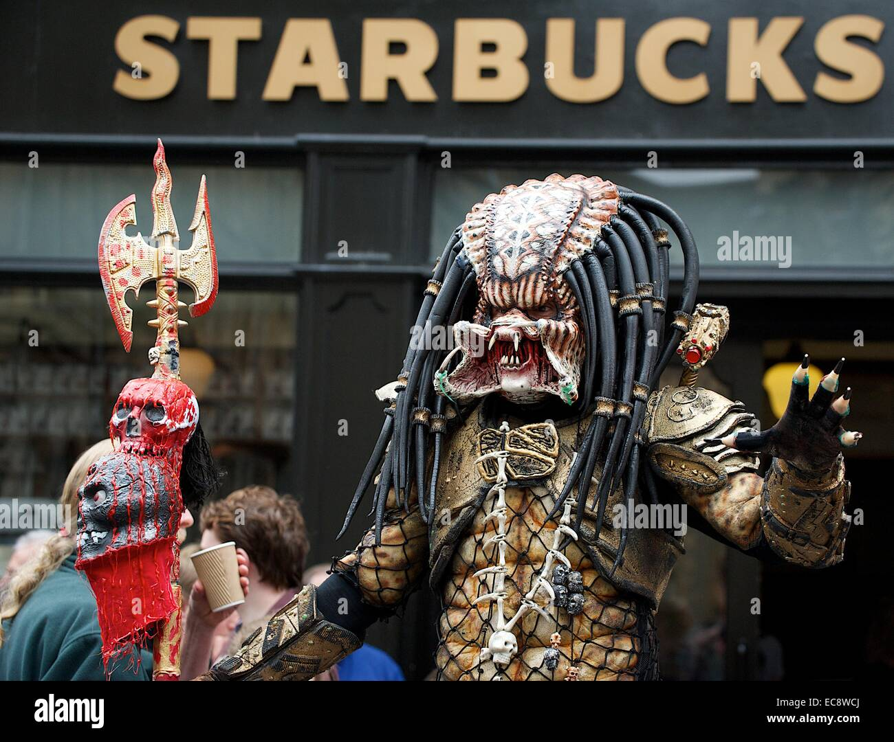 Performer in Alien Predator costume outside Starbucks in Edinburgh & Performer in Alien Predator costume outside Starbucks in Edinburgh ...