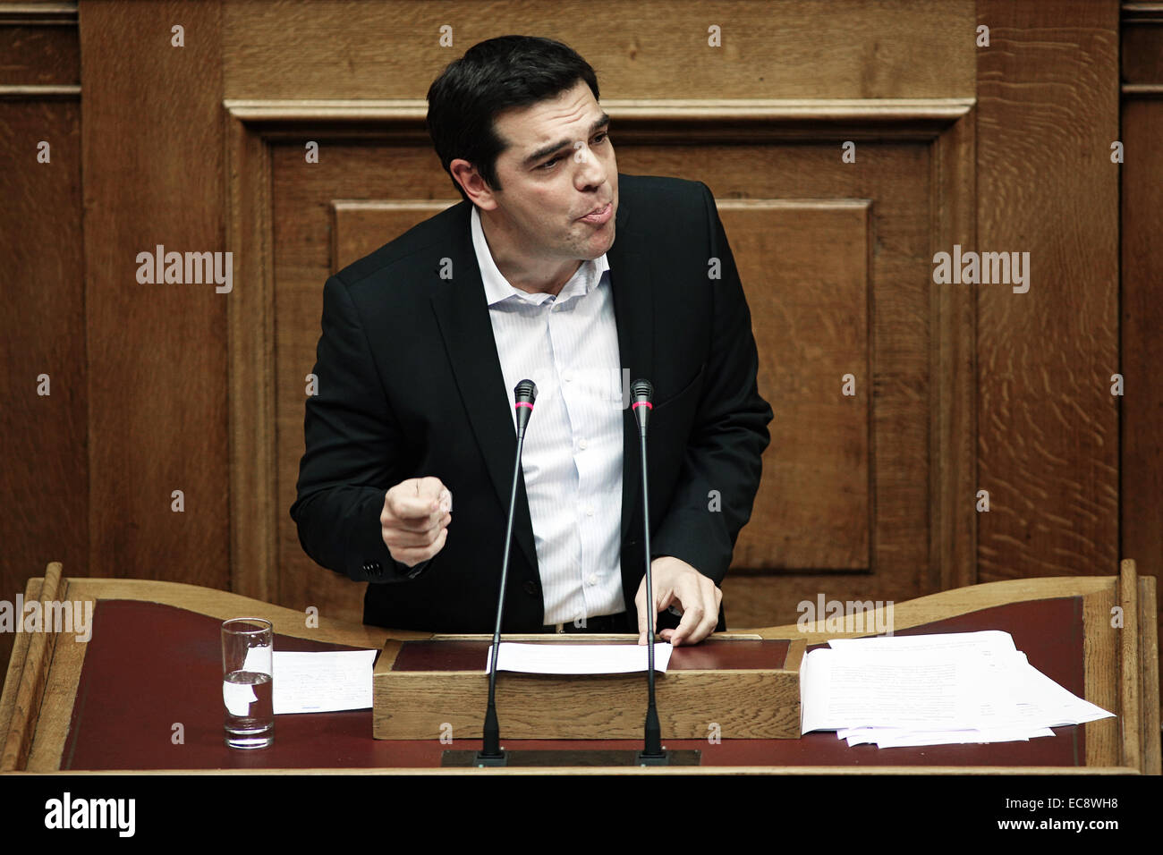 Greece's main opposition leader Alexis Tsipras of Syriza party speaks during a parliament meeting for a vote - Stock Image
