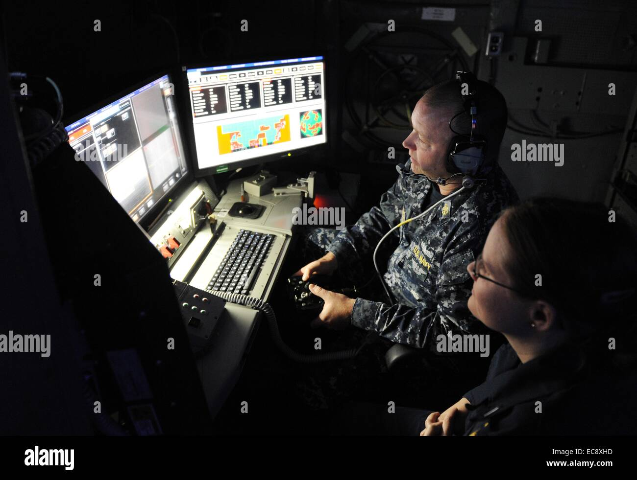 US Navy sailors operate the newly deployed LaWS, Laser Weapon System aboard the Austin-class amphibious transport - Stock Image