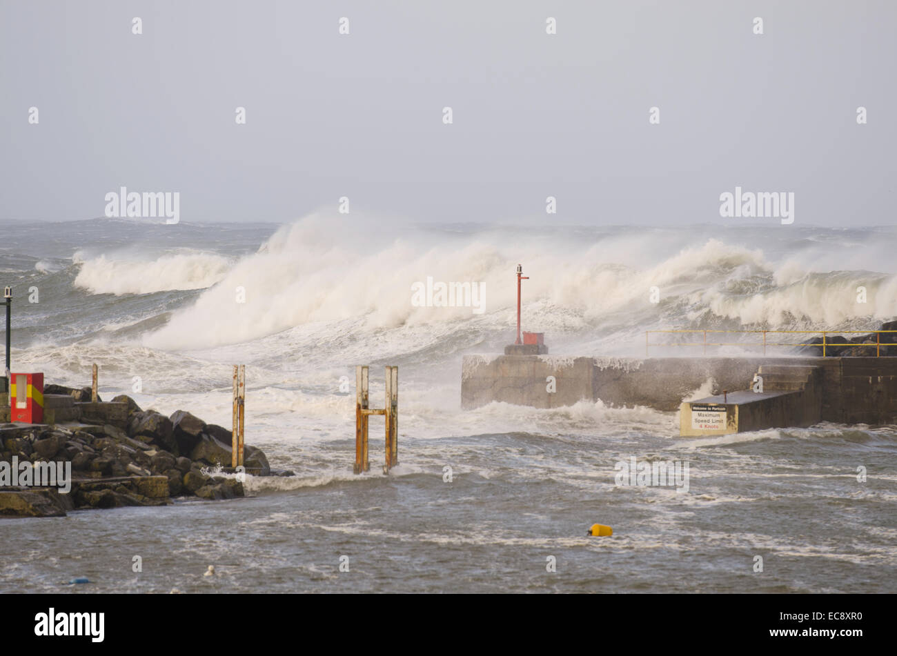 Portrush, Northern Ireland, UK. 10th Dec, 2014. Massive waves pound the Harbour Portrush Northern Ireland. The intense - Stock Image