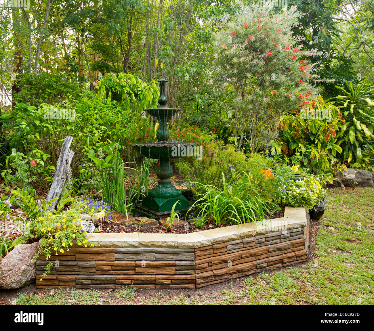Spectacular Garden Water Feature, Ornate Cast Iron Fountain U0026 Mass Of  Colourful Plants U0026 Flowers Surrounded By Low Stone Wall