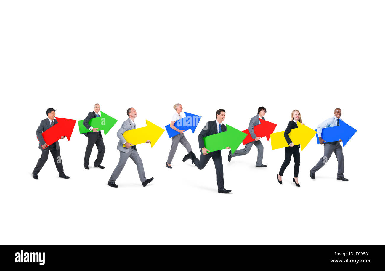 Group of Business People Holding Arrow Signs while Moving Forward - Stock Image