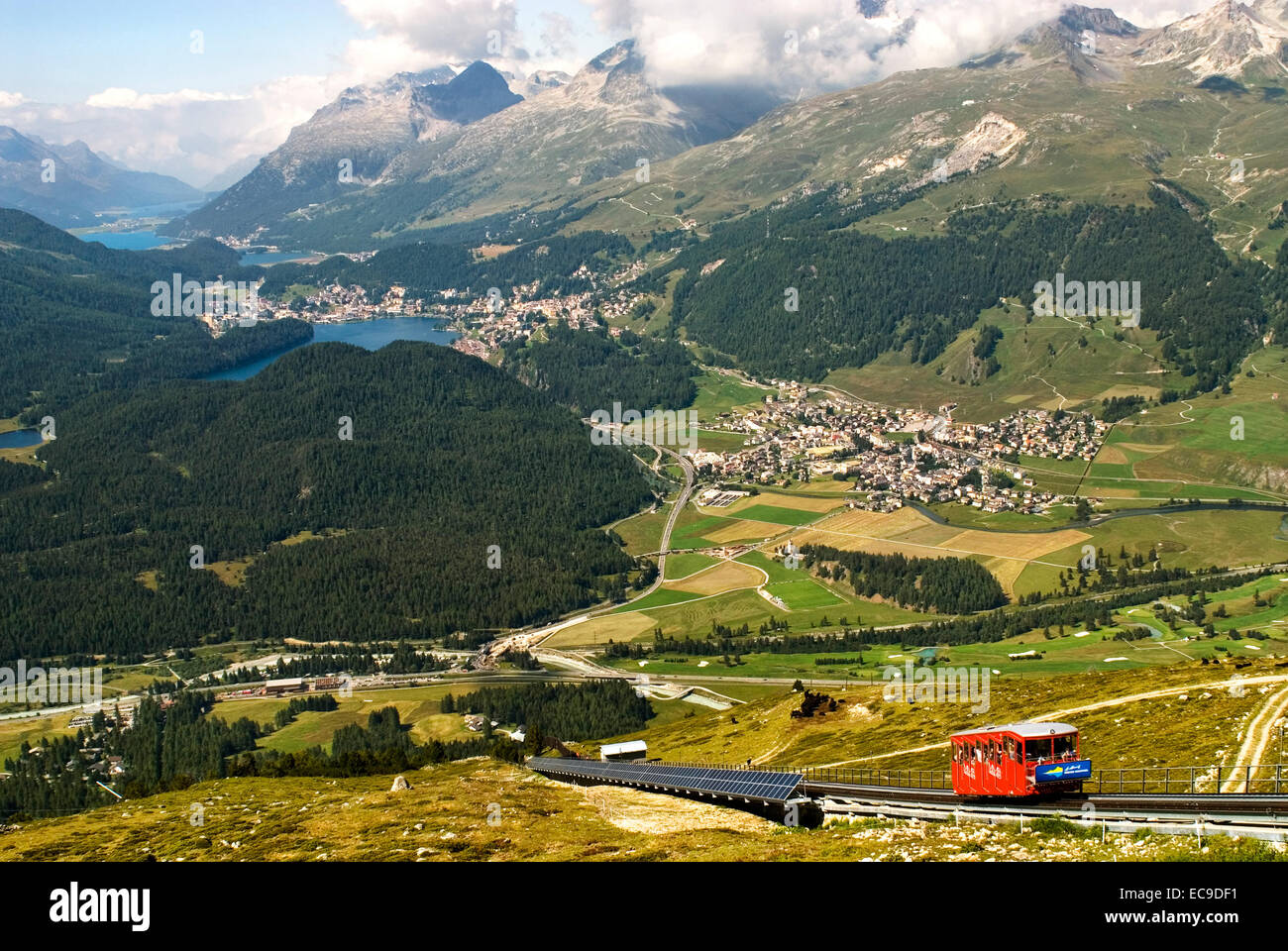 Cable car going up Muottas Muragl with the Upper Engadin Lakes in the background, Engadin, Switzerland Standseilbahn Stock Photo