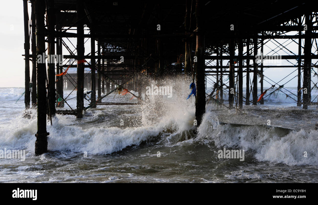 Waves crash under Brighton Pier this morning as storms batter Britain again today December 2014 Stock Photo