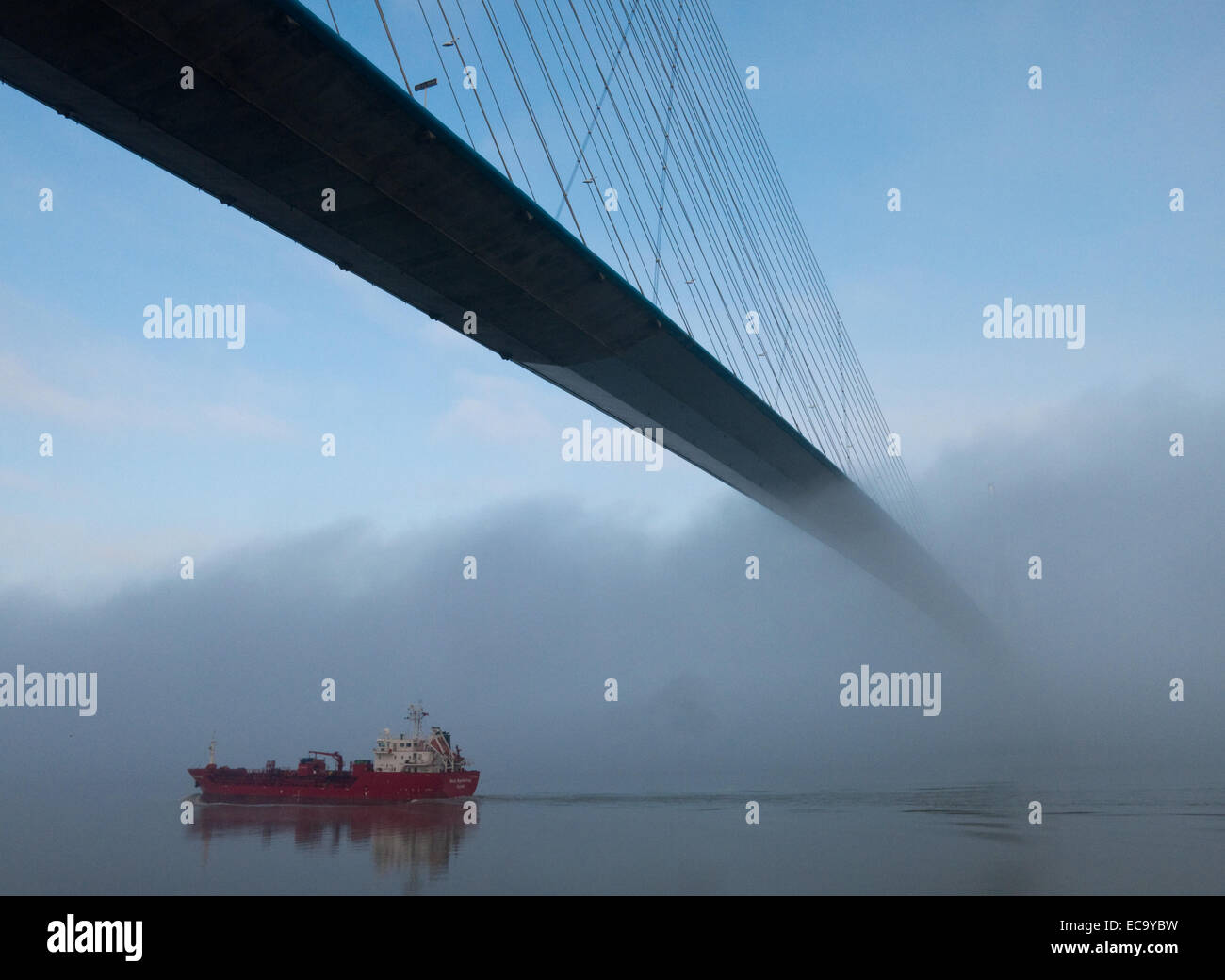 A Stolt tanker passes underneath the Pont de Normandie over the Seine river between Honfleur and Le Havre, France - Stock Image