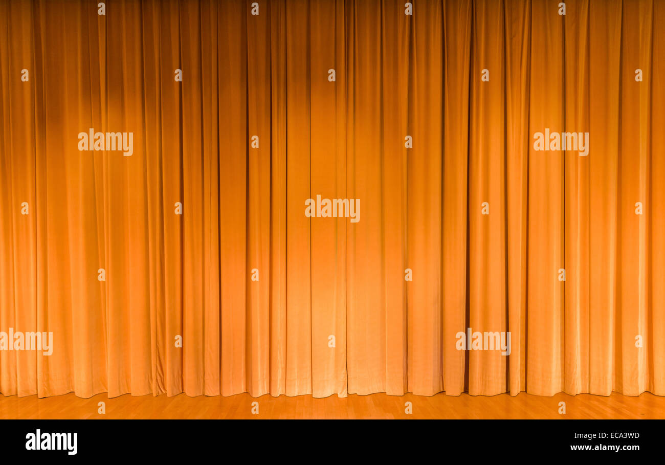 A curtain in yellow, theater stage - Stock Image