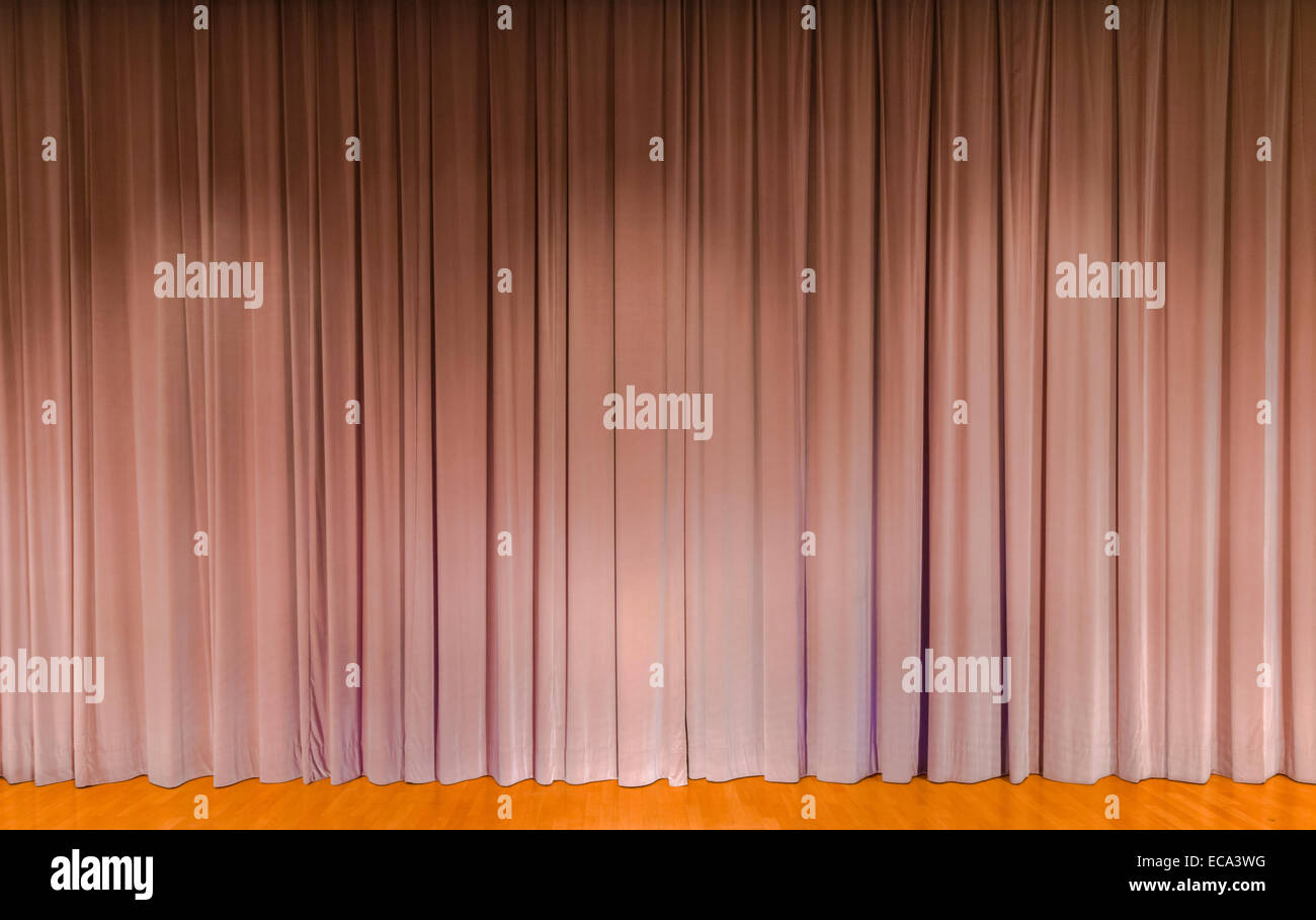 A curtain in beige, theater stage - Stock Image