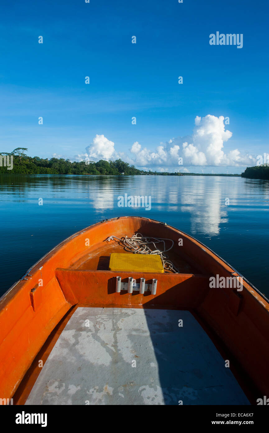 Boat cruising on a river in Pohnpei, Micronesia - Stock Image