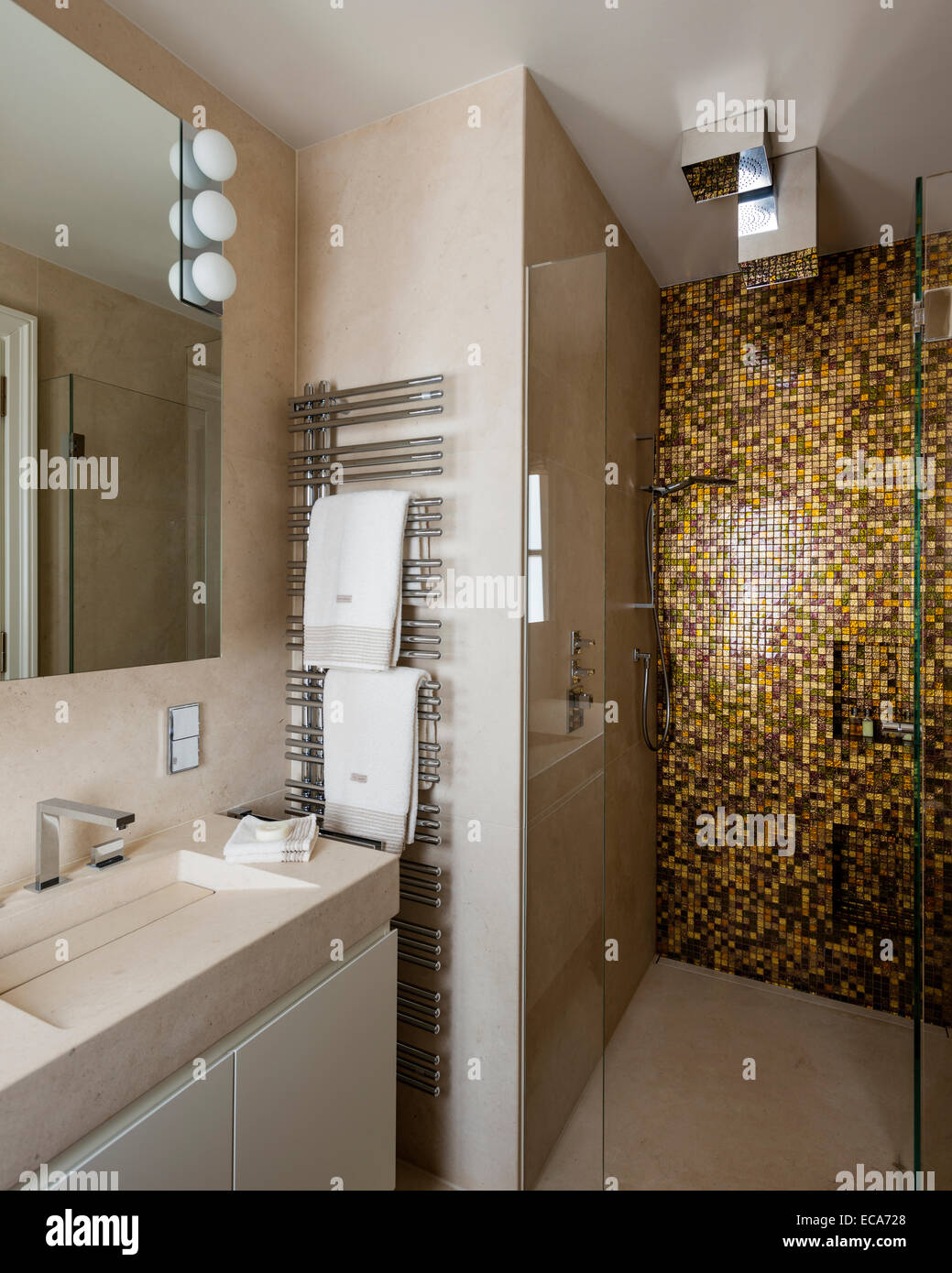 Double vanity unit and bathroom with gold tiled shower unit Stock ...