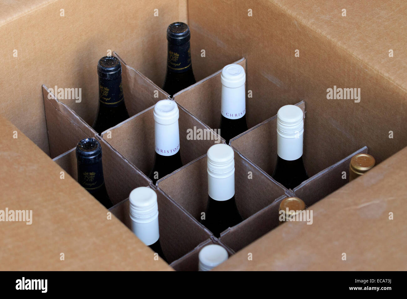 Case of wine in a cardboard box - Stock Image