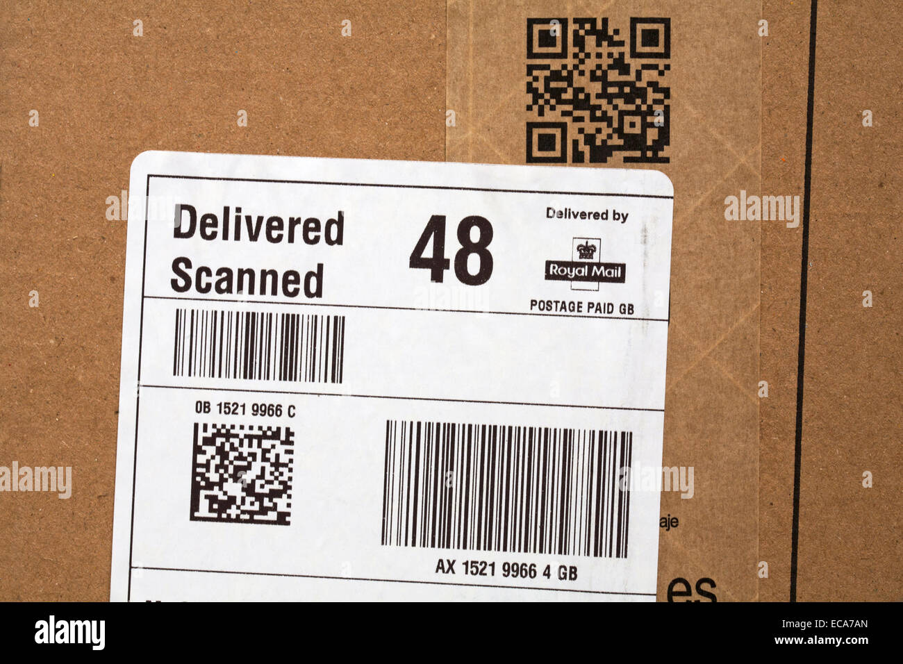 Delivered scanned, delivered by Royal Mail and scan me on parcel from Amazon - Stock Image
