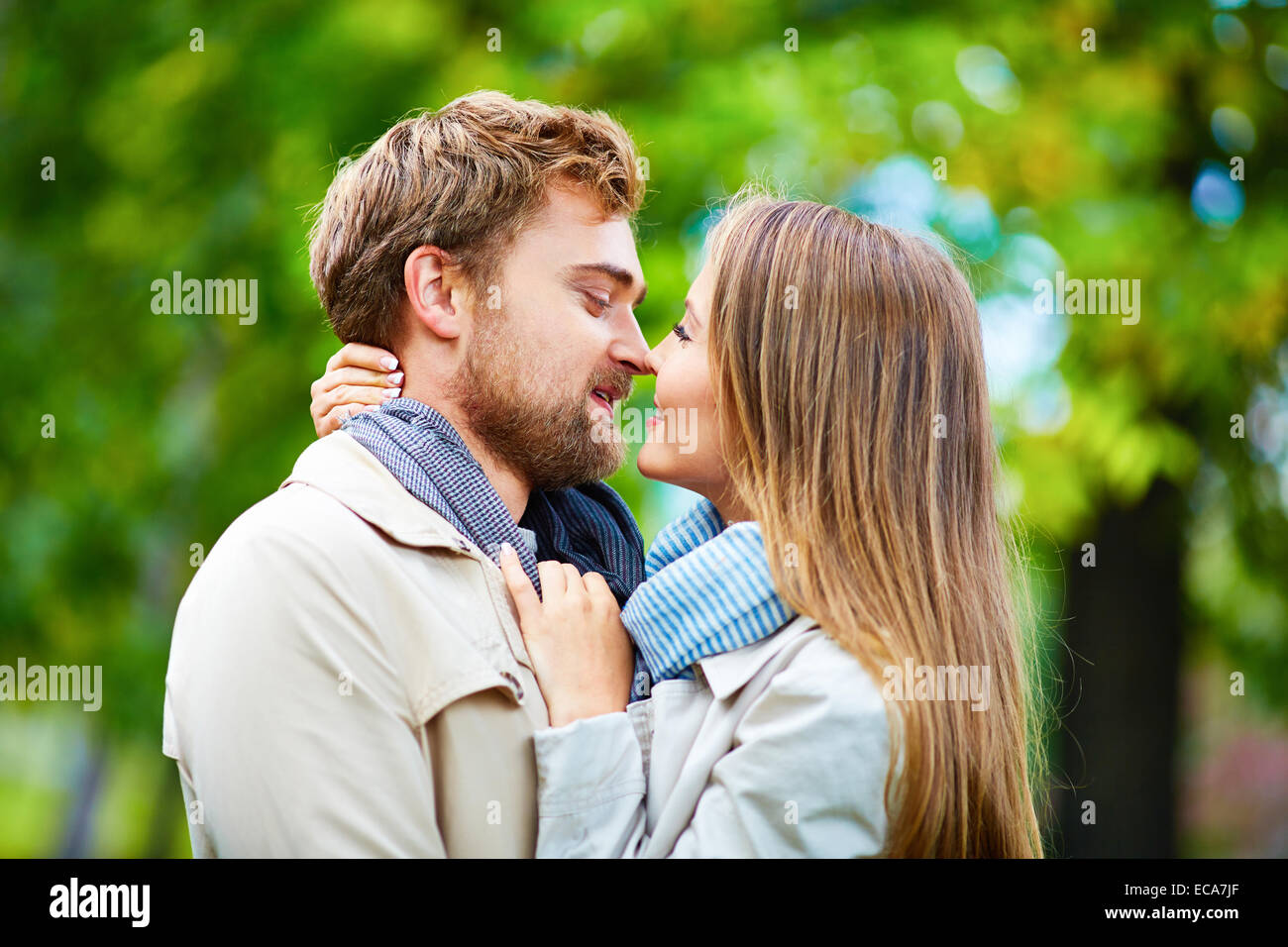 Romantic couple looking at one another in embrace - Stock Image