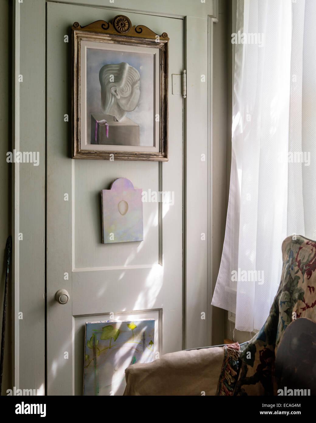 Salle Werner Vaughn artwork hangs on a cupboard - Stock Image