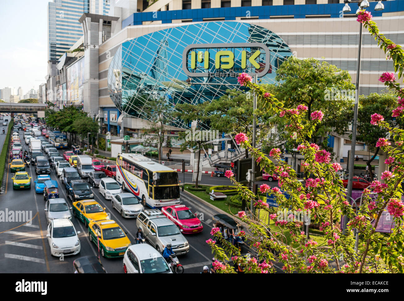 Streetscape with traffic jam in the city centre in front of the MBK Building, Bangkok, Thailand Stock Photo