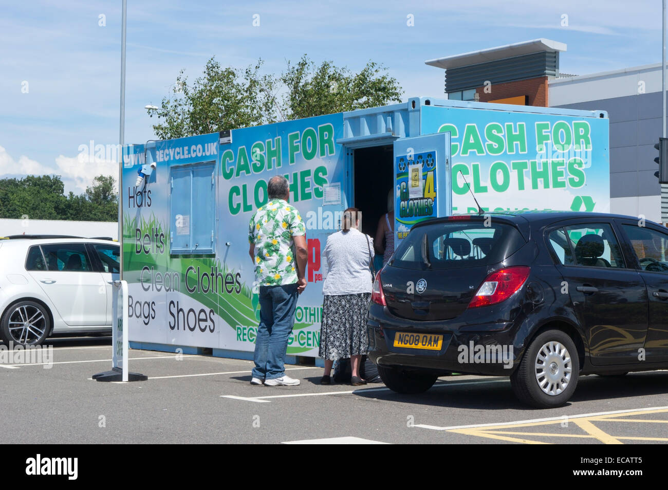 ea5d0892b8 People queueing at a Cash for Clothes recycling centre. - Stock Image