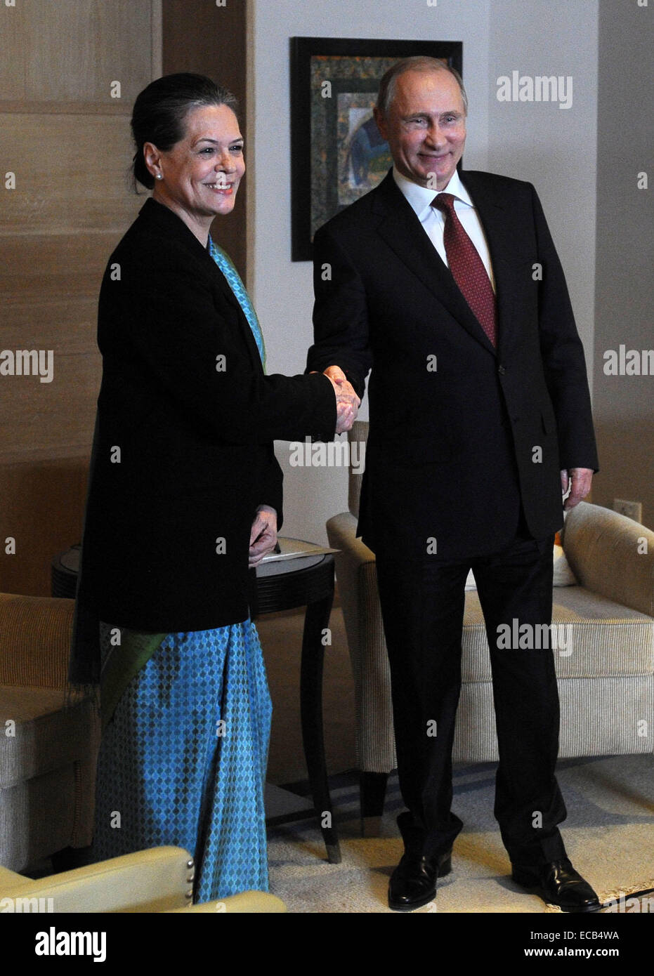 New Delhi, India. 11th Dec, 2014. Russia's president Vladimir Putin (R) shakes hands with Sonia Gandhi president - Stock Image