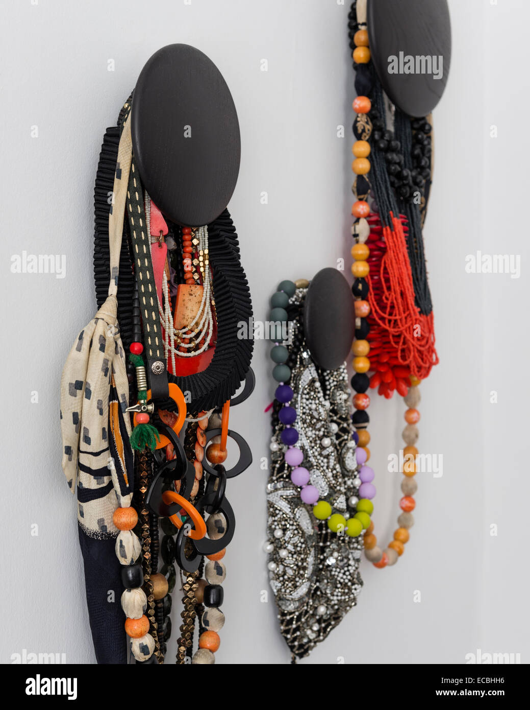 Beaded necklaces hung from the wall - Stock Image